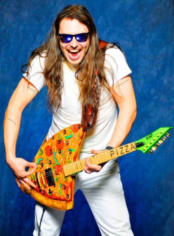 Andrew W.K. playing his pizza guitar. Pizza=love